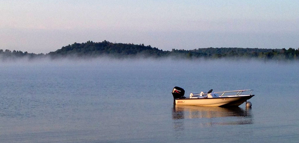 Early morning mist on lake in Muskoka
